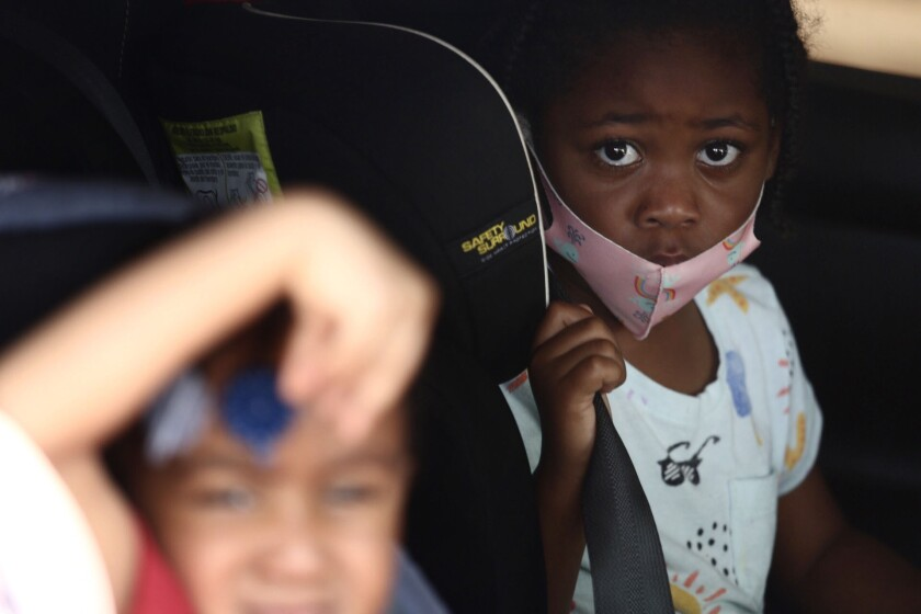 Children in car at a coronavirus drive-up testing site