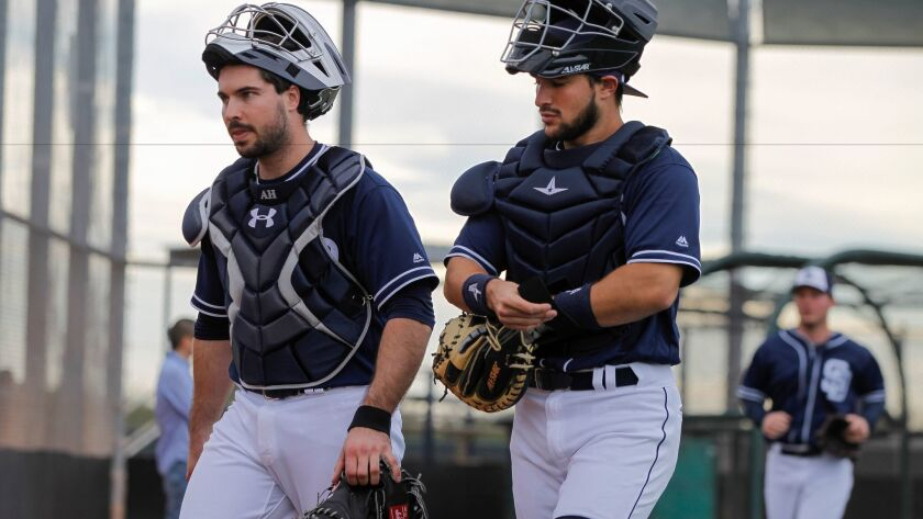 Padres catchers Austin Hedges, left, and Luis Torrens during spring training at the Peoria Sports Complex in Peoria, Arizona on Friday, Feb. 17, 2017.