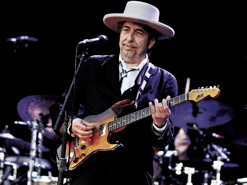 A 2012 file photo shows Bob Dylan performing in France. Dylan refused to allow photographs at his show Saturday with Mavis Staples at the Santa Barbara Bowl, part of a tour that reaches the Shrine Auditorium in Los Angeles on Thursday.