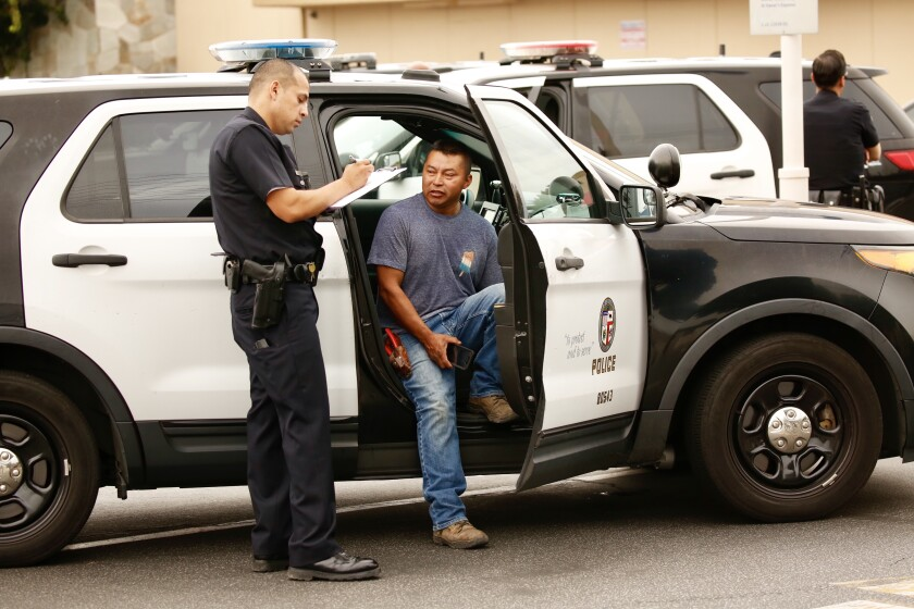 L.A. police talk to a attempted robbery victim at a Bank of America branch at Sherman Way and Topanga Canyon Boulevard in Canoga Park.