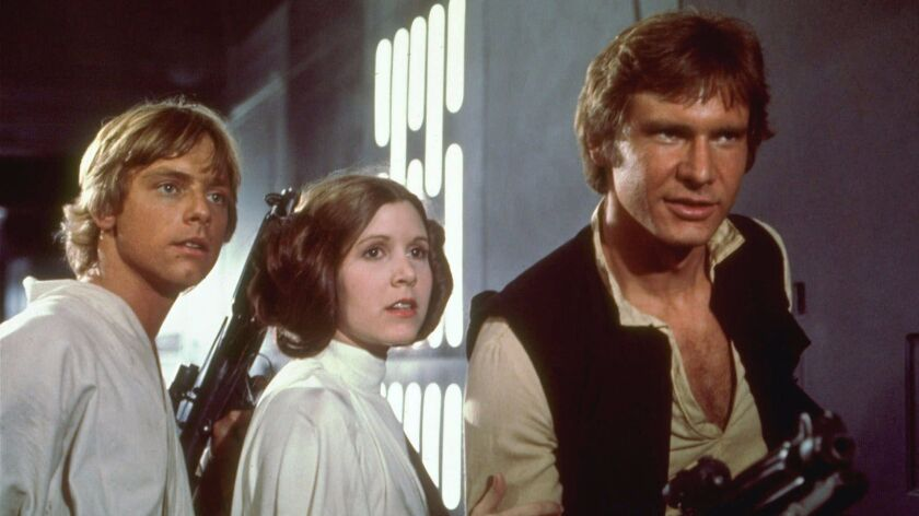"""Mark Hamill, left, Carrie Fisher, center, and Harrison Ford, right, are shown in a scene from the 1977 film """"Star Wars."""""""