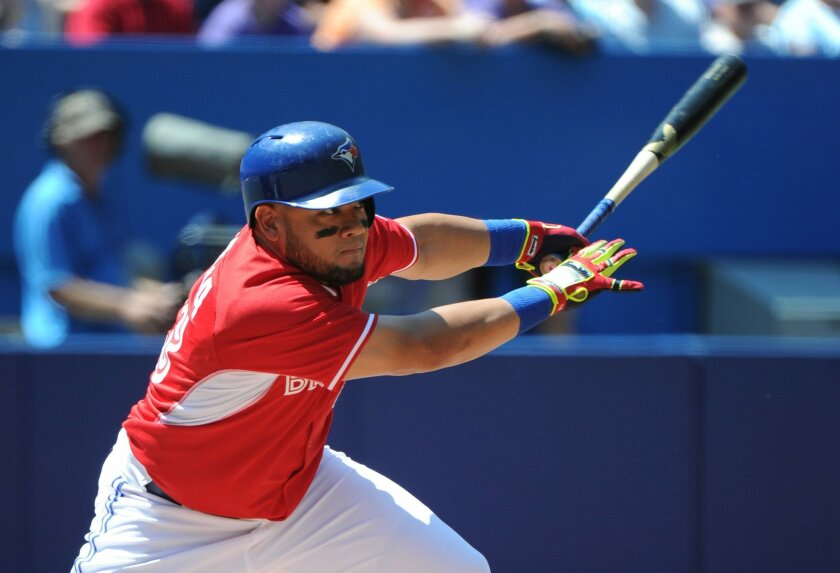 Toronto Blue Jays' Melky Cabrera singles against the Detroit Tigers during the first inning of a baseball game on Sunday, Aug. 10, 2014, in Toronto. (AP Photo/The Canadian Press, Jon Blacker)