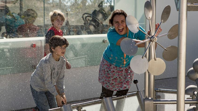Children play in a whitewater exhibit on the museum's Sky Garden.