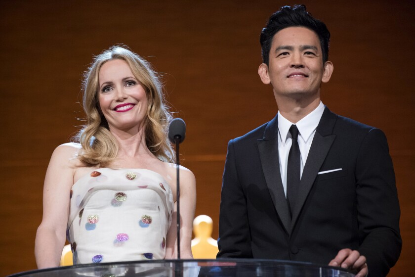 Leslie Mann and John Cho host the Academy of Motion Picture Arts and Sciences' Scientific and Technical Awards on Saturday in Beverly Hills.