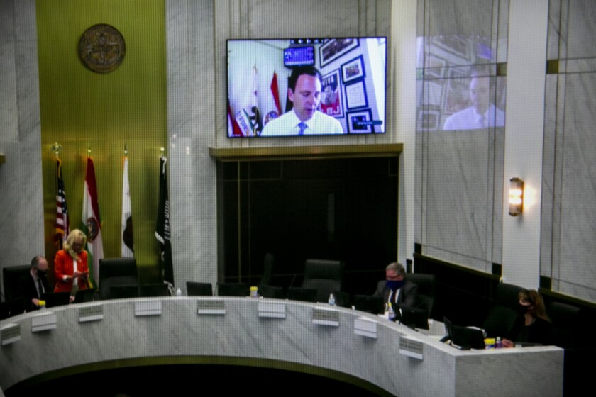 County Supervisor Nathan Fletcher appears virtually at a meeting of the San Diego County Board of Supervisors, seen here on the photographer's computer screen, on May 19, 2020 in San Diego, California.