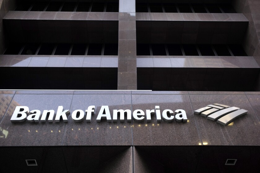 FILE - In this Oct. 14, 2019, file photo a Bank of America logo is attached to the exterior of the Bank of America Financial Center building in Boston. Bank of America reports financial results Wednesday, Jan. 15, 2020. (AP Photo/Steven Senne)
