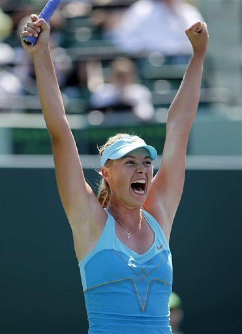 Maria Sharapova, of Russia, celebrates  her 3-6, 6-0, 6-2 win against Andrea Petkovic at the Sony Ericsson Open tennis tournament in Key Biscayne, Fla., Thursday, March 31, 2011. (AP Photo/Alan Diaz)