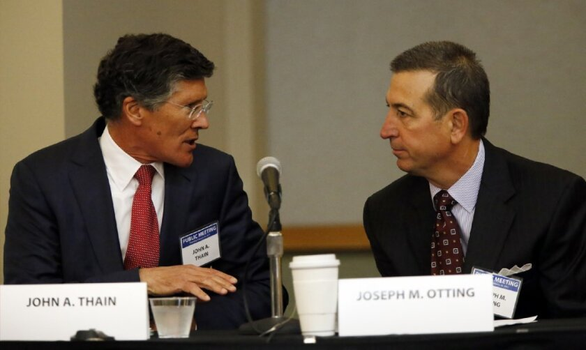 Bank regulators have approved CIT Group's takeover of OneWest Bank in Pasadena. Above, CIT Chief Executive John Thain and Onewest CEO Joseph Otting appeared at a Federal Reserve hearing on the merger in February.