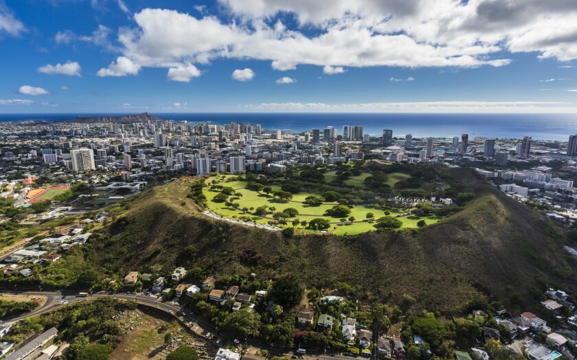 The National Memorial Cemetery of the Pacific sits in a volcano crater overlooking Honolulu.