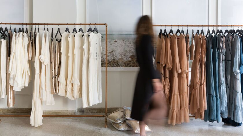 Racks of women's apparel as well as original photos of the Pacific Ocean by Sharon Montrose ($1,350 unframed) are available at Heidi Merrick'™s new H. Merrick of California boutique in downtown L.A.