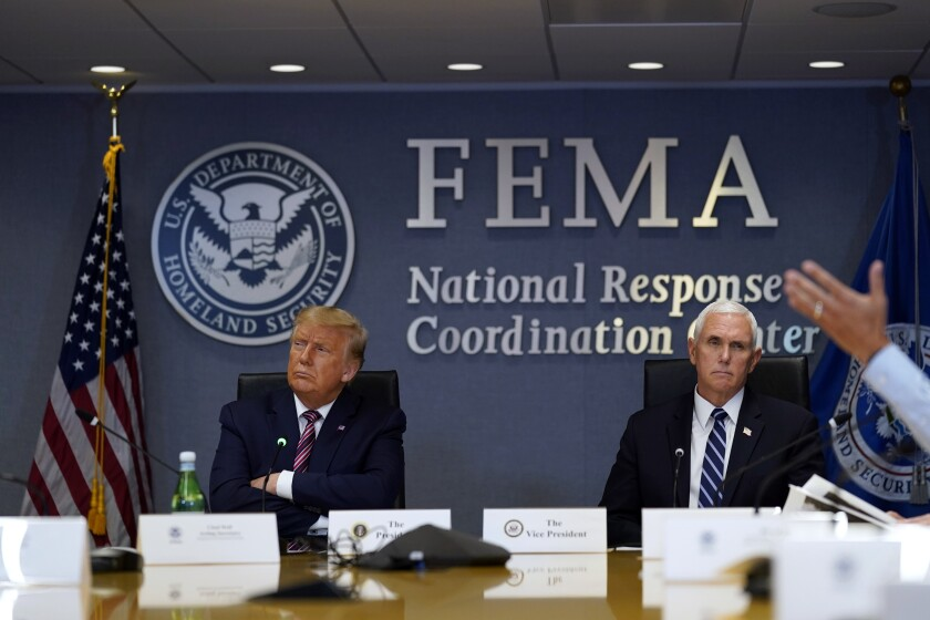 President Trump and Vice President Mike Pence at a Hurricane Laura briefing at FEMA headquarters on Thursday.