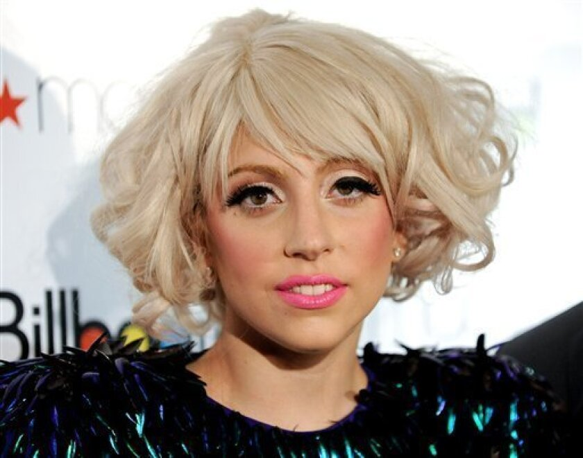 Singer Lady Gaga arrives at the Billboard Women In Music brunch, where she received the Rising Star award at The Pierre Hotel on Friday, Oct. 2, 2009 in New York. (AP Photo/Evan Agostini)