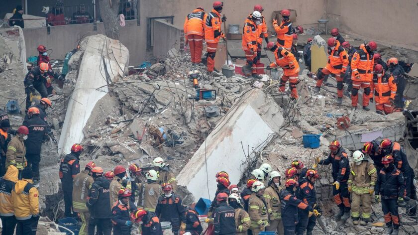 Rescuers work at the site of the collapsed building in the Kartal district of Istanbul, Turkey.