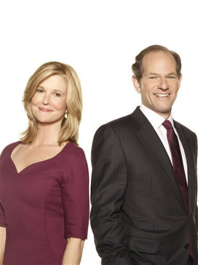 "In this publicity image released by CNN, Kathleen Parker, left, and Eliot Spitzer, hosts of the CNN prime-time show ""Parker Spitzer."" (AP Photo/CNN, Art Streiber)"