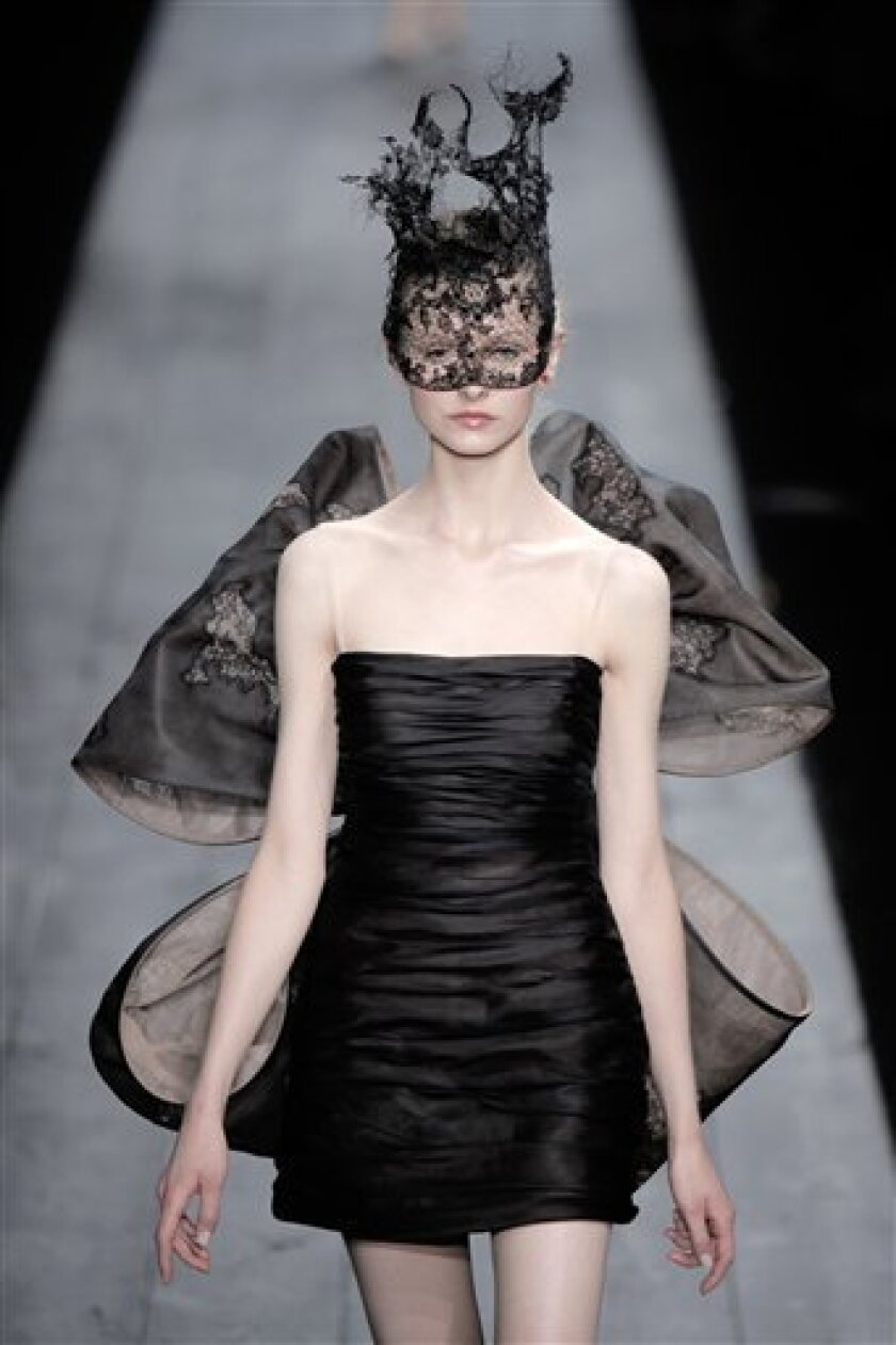 A model wears a creation by Italian designers Maria Grazia Chiuri and Pier Paolo Piccioli as part of their Valentino's show during the Haute Couture Fall/Winter 2009-2010 fashion collection, presented in Paris, Wednesday July 8, 2009. (AP Photo/Thibault Camus)
