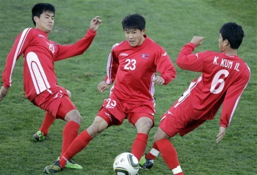 From left, North Korea's Ri Kwang Hyok, Jong Tae Se and Kim Kum Il challenge for the ball   during a team training session in Tembisa near Johannesburg, South Africa,  Tuesday June 8, 2010. North Korea  are preparing for the upcoming soccer World Cup, where they will play in Group G. (AP Photo/Fran
