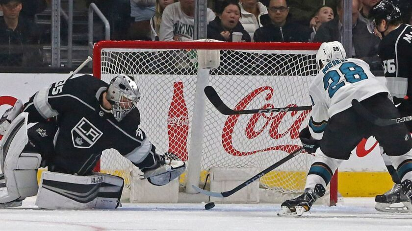 Los Angeles Kings goalie Darcy Kuemper (35) stops a shot by San Jose Sharks right winger Timo Meier