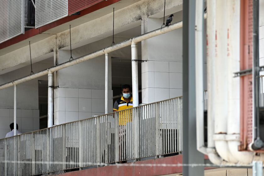 A foreign worker looks out from a window of a dormitory in Singapore on April 9.