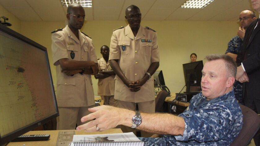 "Navy Rear Adm. Kenneth ""KJ"" Norton meets with Senagalese military officials in 2012. He retired two years later."