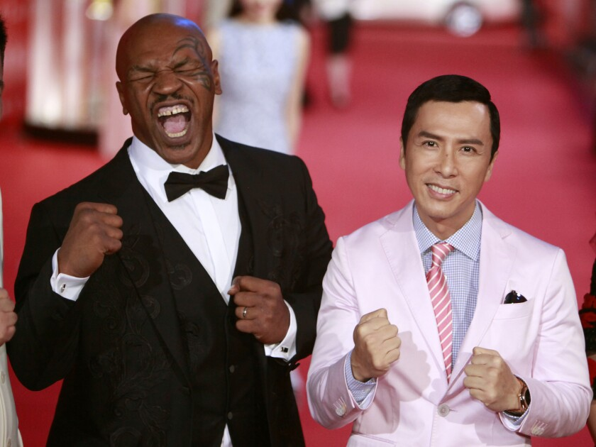 Mike Tyson, left, and Donnie Yen pose for a picture on the red carpet at the 18th Shanghai International Film Festival on June 13, 2015, in Shanghai.