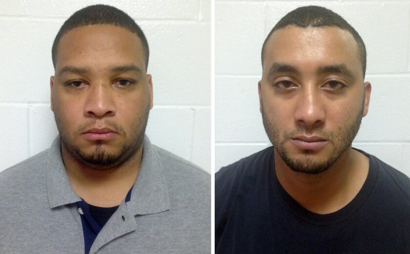 In this photo combination shows booking photos provided by the Louisiana State Police, Marksville City Marshal Derrick Stafford, left, and Marksville City Marshal Norris Greenhouse Jr., both were arrested on charges of second-degree murder and attempted second-degree murder in the fatal shooting of