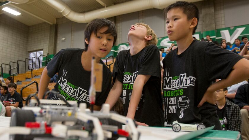 Mesa View Middle School students Colin Dang, 12, James Kormanik, 13, and Benjamin Huinh, 13, from le