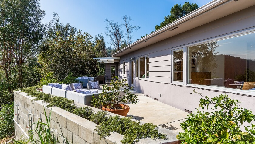 The 1950 house in Hollywood Hills West has extensive deck and patio space.