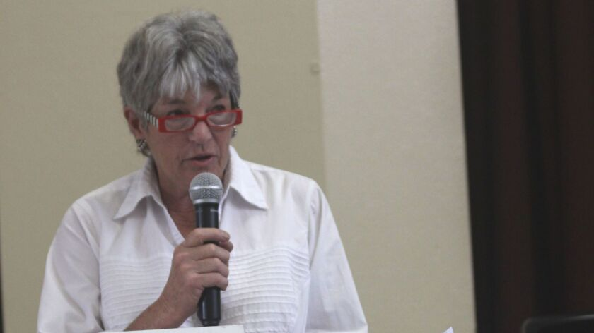 Trustee Gail Forbes eulogizes swimmer and community advocate Ann Cleveland, during the July 13 La Jo