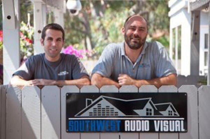 Bill Kauzlarich, left, and Jim Diez, owners of Solana Beach's Southwest Audio Visual