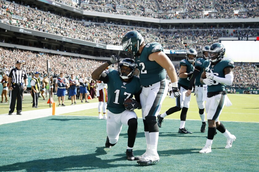 Philadelphia Eagles' Alshon Jeffery, left, celebrates with Jason Kelce after scoring a touchdown during the second half of an NFL football game against the Washington Redskins, Sunday, Sept. 8, 2019, in Philadelphia. (AP Photo/Matt Rourke)