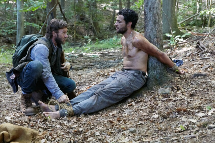 """Joel Edgerton as Paul and Christopher Abbott as Will in the film """"It Comes At Night."""""""