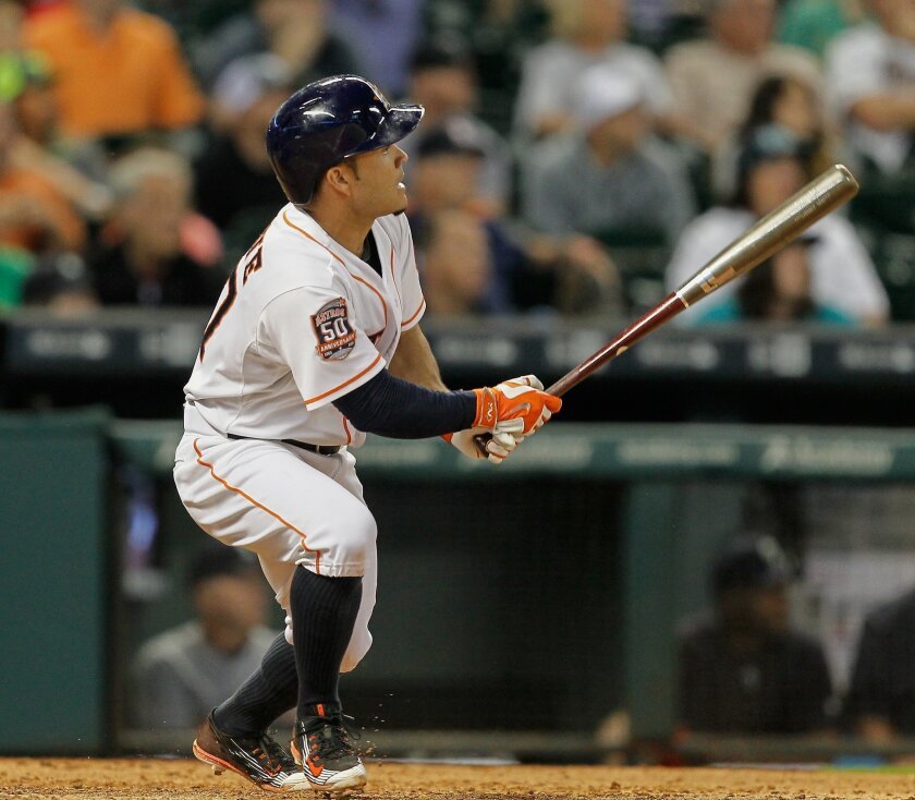 Houston Astros' Jose Altuve singles in the winning run in the tenth inning against the Seattle Mariners in a baseball game Thursday April 30, 2015 in Houston. (AP Photo/Bob Levey)