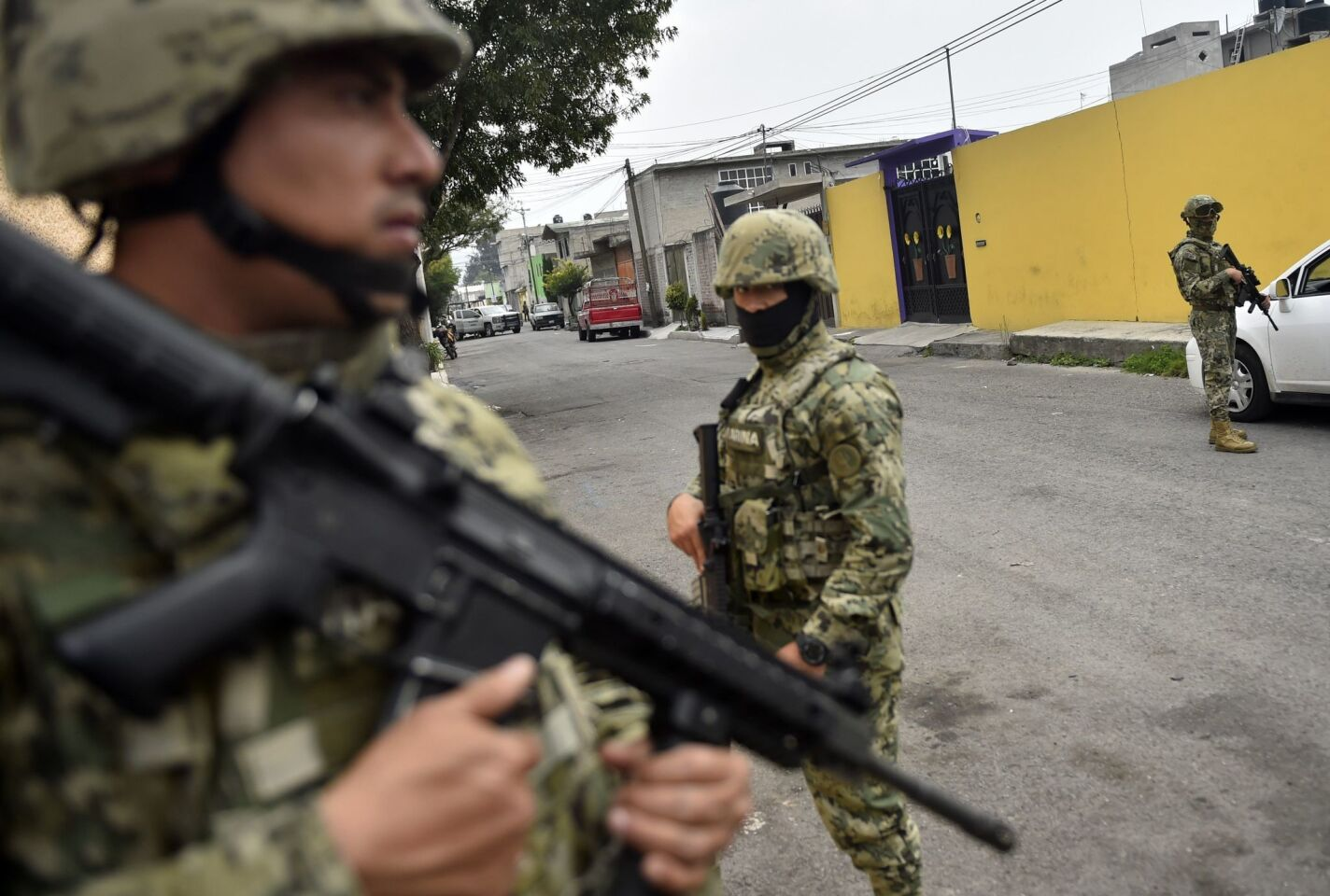 Mexican marines guard the scene of a shootout in which eight suspected drug traffickers were shot dead in Tlahuac, Mexico City on July 20, 2017.
