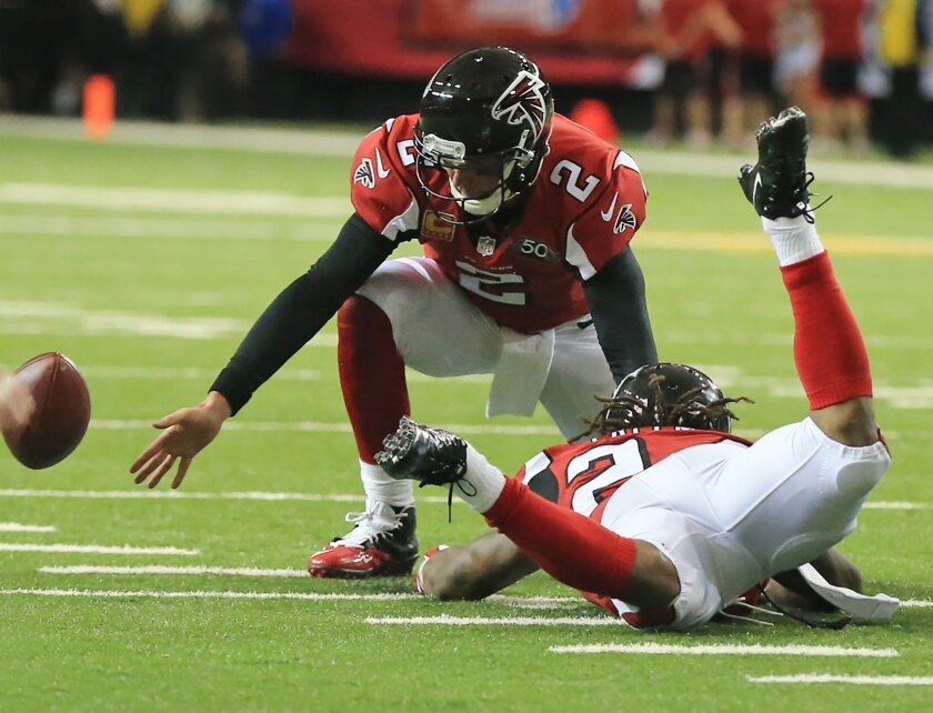 Atlanta Falcons quarterback Matt Ryan fumbles the ball away to the Tampa Bay Buccaneers on the snap trying to hand off to running back Devonta Freeman during the second quarter of an NFL football game on Sunday, Nov. 1, 2015, in Atlanta. (Curtis Compton/Atlanta-Journal Constitution via AP) MARIETTA