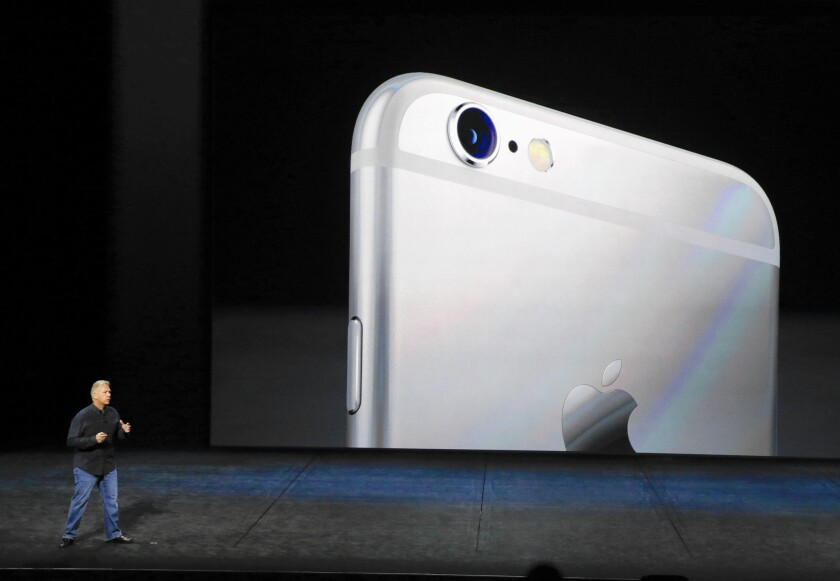 Attorneys for Apple are researching legal tactics to compel the government to turn over specifics on how it unlocked an iPhone 5c. Above, an Apple exec touts the features of the latest iPhones.