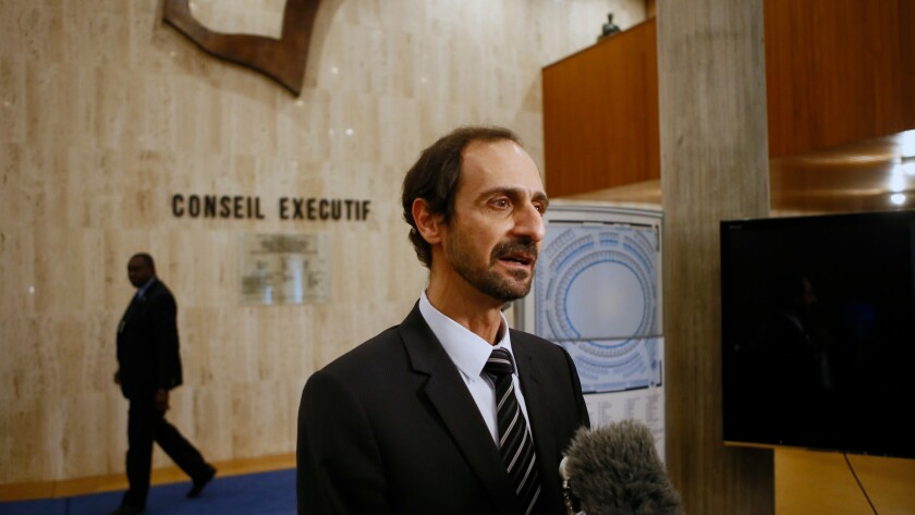 Palestinian deputy ambassador to UNESCO Mounir Anastas, speaks to the media as he walks out of the meeting room at UNESCO's headquarters in Paris on Monday.