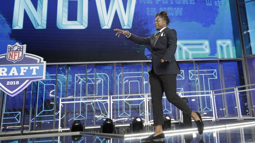 Central Florida's Shaquem Griffin walks out onto the stage at the start of the first round of the NFL draft.