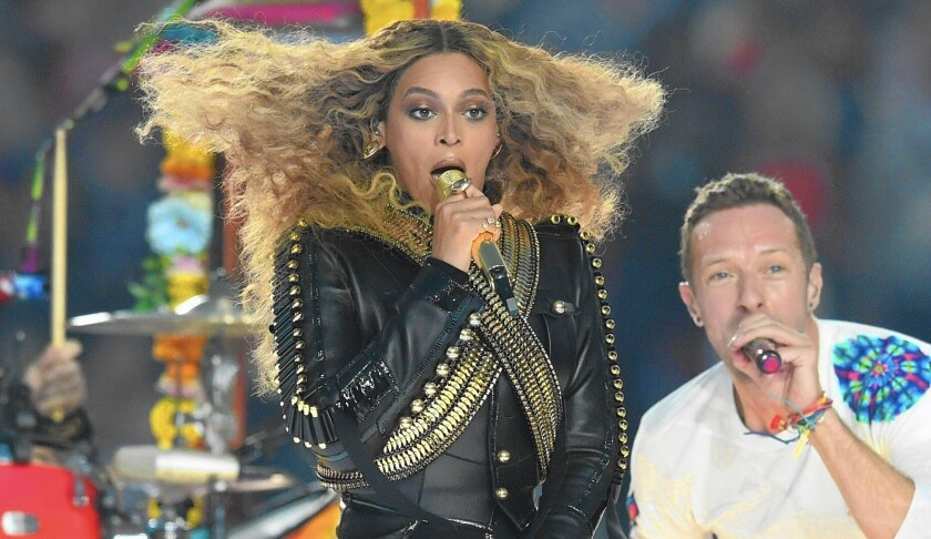Artists like Beyoncé must walk a tightrope between promoting their art and annoying fans who may not want to subscribe to a new subscription service. Above, Beyoncé performs with Coldplay's Chris Martin during halftime at Super Bowl 50.