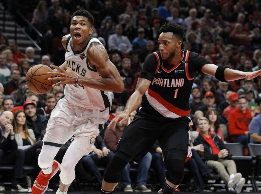 Bucks forward Giannis Antetokounmpo drives to the basket against Trail Blazers guard Evan Turner during the second half of their game Nov. 6.