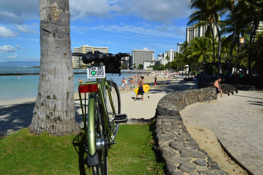 Waikiki's beaches feature prominently in a cycling tour of Honolulu that is included in a new hotel package intended to reduce visitors' carbon footprints.