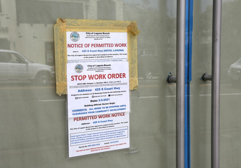 A stop work order sign on the front doors of the Hotel Laguna as shown on May 12, 2021.