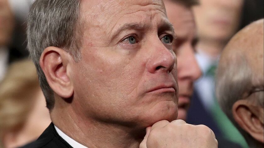 Chief Justice John Roberts, watching the 2018 State of the Union address, has kept the Supreme Court ideologically centered.