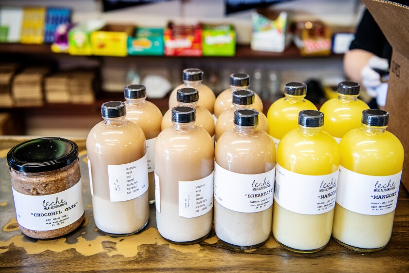 A variety of oat milks from Leche on display at Sara's Market.