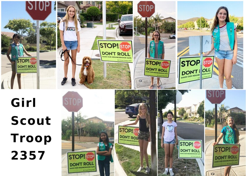 Troop 2357 Junior Girl Scouts with the signs they installed in 4S Ranch at four intersections to remind drivers to stop.