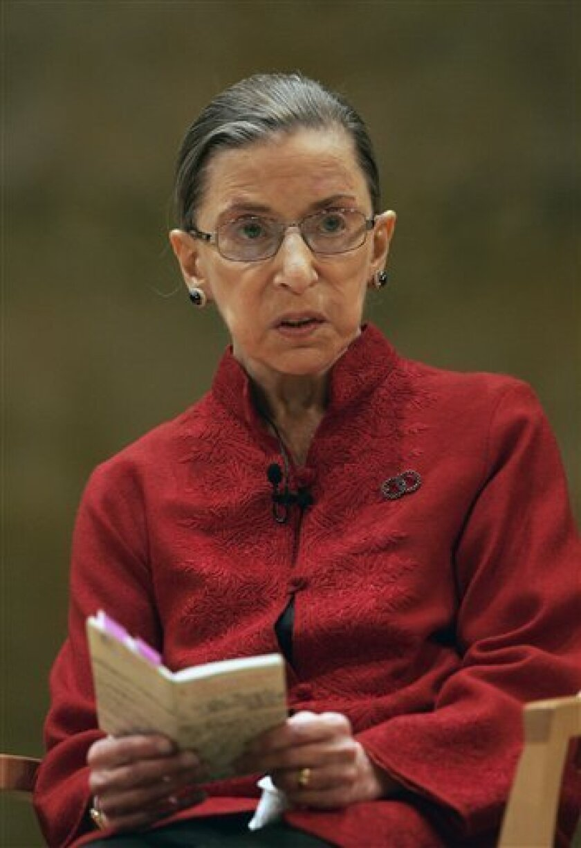 In this Oct. 23, 2008 file photo, Supreme Court Justice Ruth Bader Ginsburg reads from a small book version of the U.S. Constitution while talking about constitutional law in Princeton, N.J. Ginsburg has been hospitalized for surgery for pancreatic cancer. (AP Photo/Mel Evans, File)