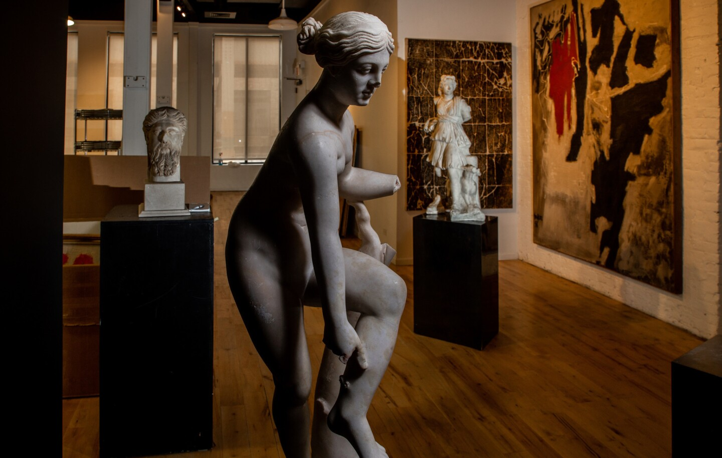 A Roman marble Venus, center, circa 2nd century C.E. and other objects from the estate of Steve and Peggy Fossett photographed at Leslie Hindman Auctioneers in Chicago on Monday, Oct. 8, 2018.