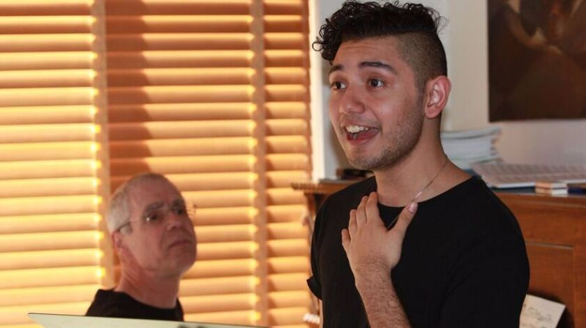 """Composer Joseph Waters (left) and singer Rodolfo Giron rehearse the new opera, """"St. Francis De Los Barrios."""""""