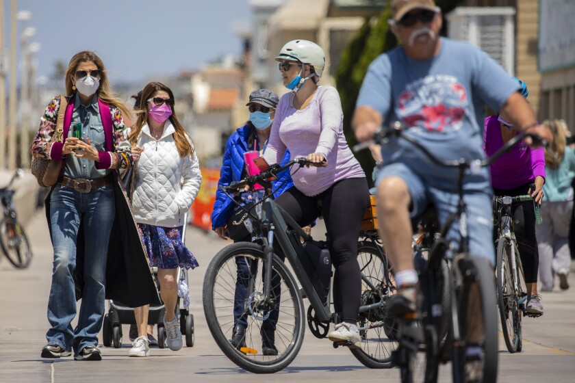 Masked and unmasked people enjoyed The Strand in Hermosa Beach last month