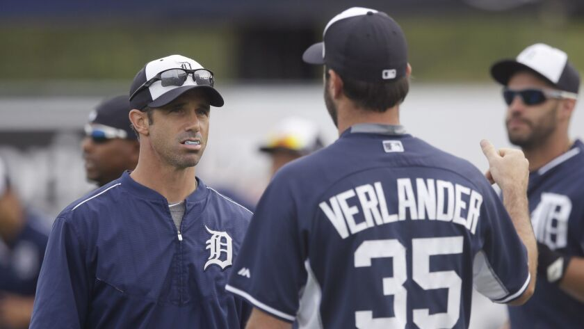 Detroit Tigers manager Brad Ausmus chats with starting pitcher Justin Verlander before a spring-training game in 2015.