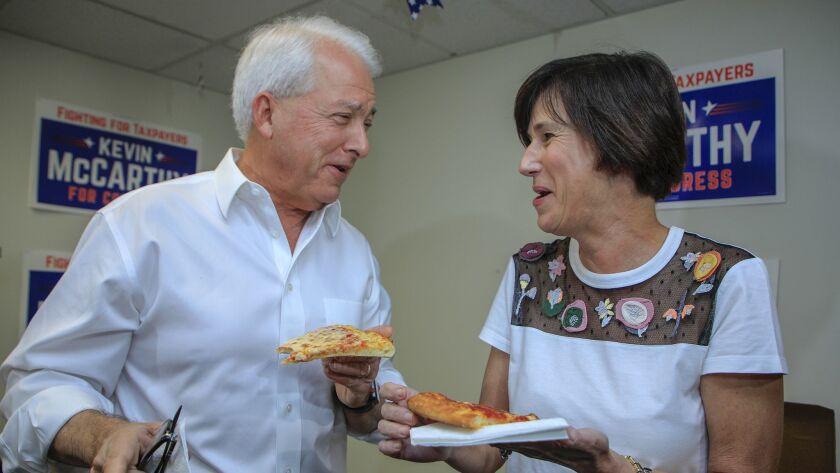 NEWPORT BEACH, CA--NOVEMBER 6, 2018: Republican gubernatorial candidate John Cox delivers a pizza
